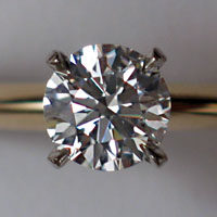 A round  diamond set in a ring.