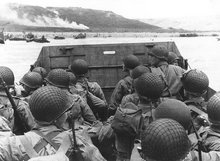 Troops in an LCVP landing craft approach Omaha beach , .
