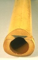 A shakuhachi, showing its utaguchi (blowing edge) and inlay