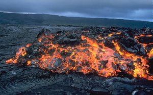 Glowing 'a'a flow front advancing over pāhoehoe on the coastal plain of Kīlauea in .